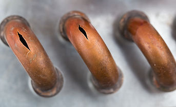 bigstock-Burst-Copper-Pipes-From-The-Co-