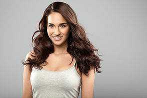 Brunette woman with dark shiny hair and