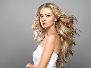 Beautiful blonde hair woman long curly h