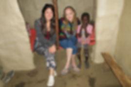 Me (left), Jen, and a Maasai boy in a Maasai home.