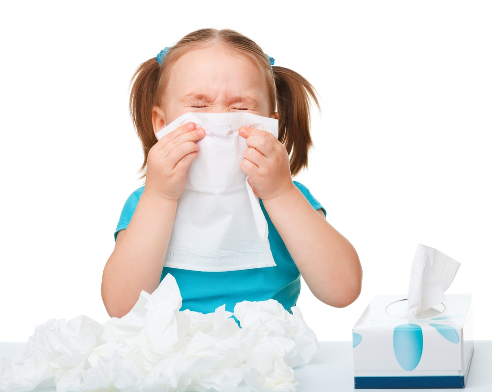 Little girl suffering from hay fever and sneezing