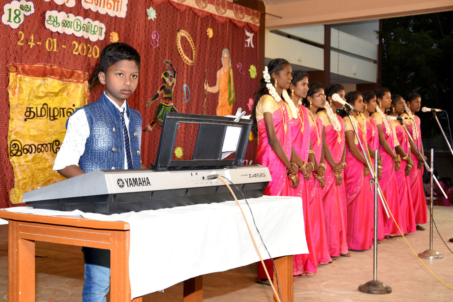 School choir melodiously  sings accompanied by keyboard master,  Sam Benial Dass, our 4th class student
