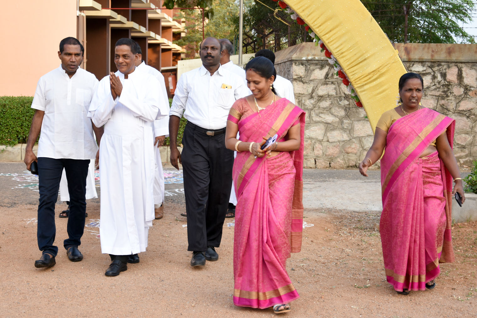 Fr. Jegath Gaspar, cheif guest, being received by the principals  of Primary and Higher Secondary Schools