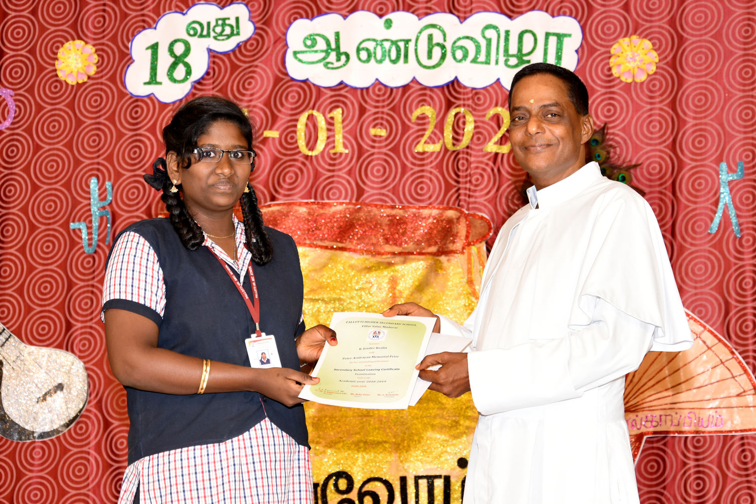 Ms. Jenifer Roslin receiving Peter Rayan Memorial Prize for her outstanding performance in the SSLC examination held in March 2019