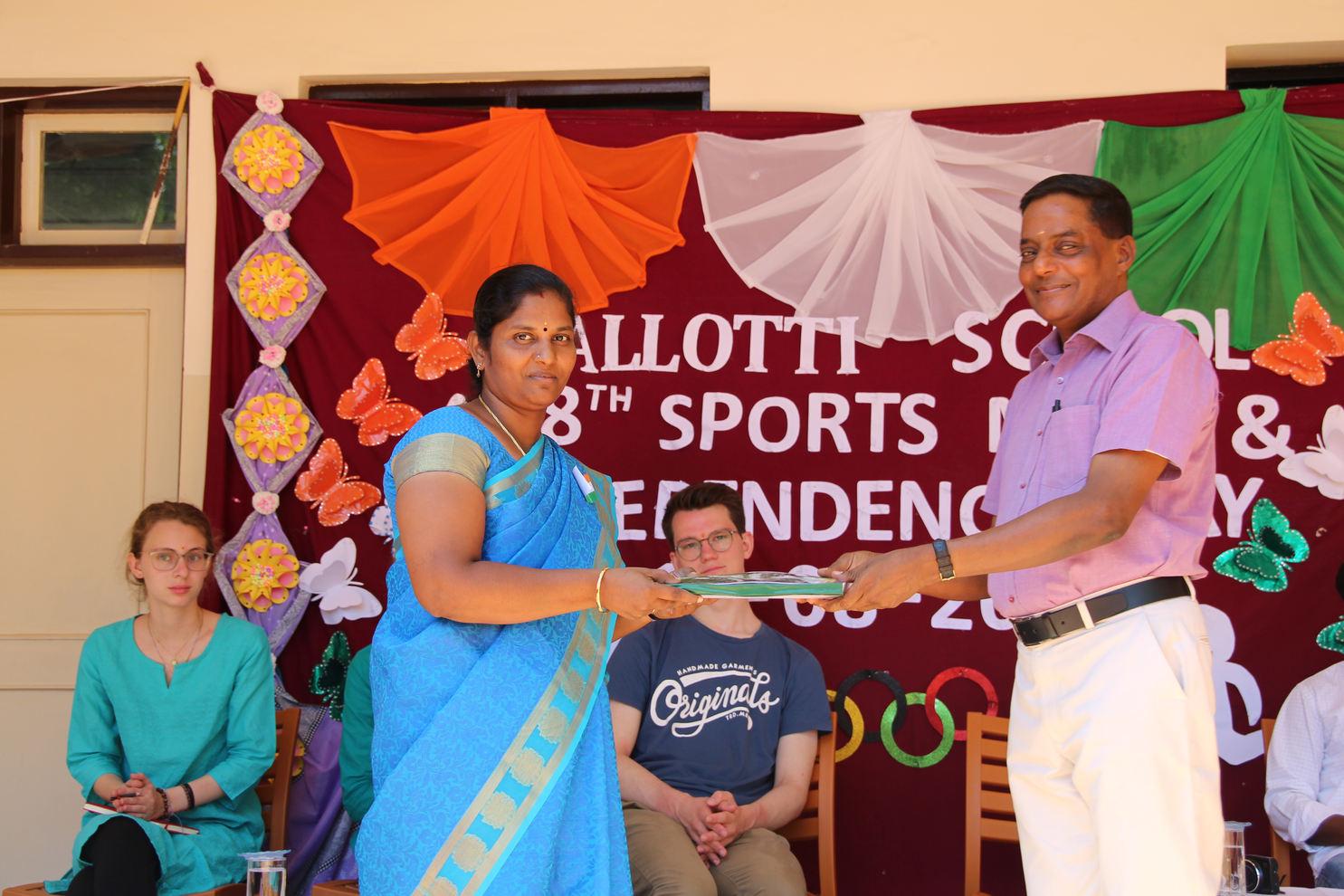 Ms. Megala, vice prinicipal, receives it