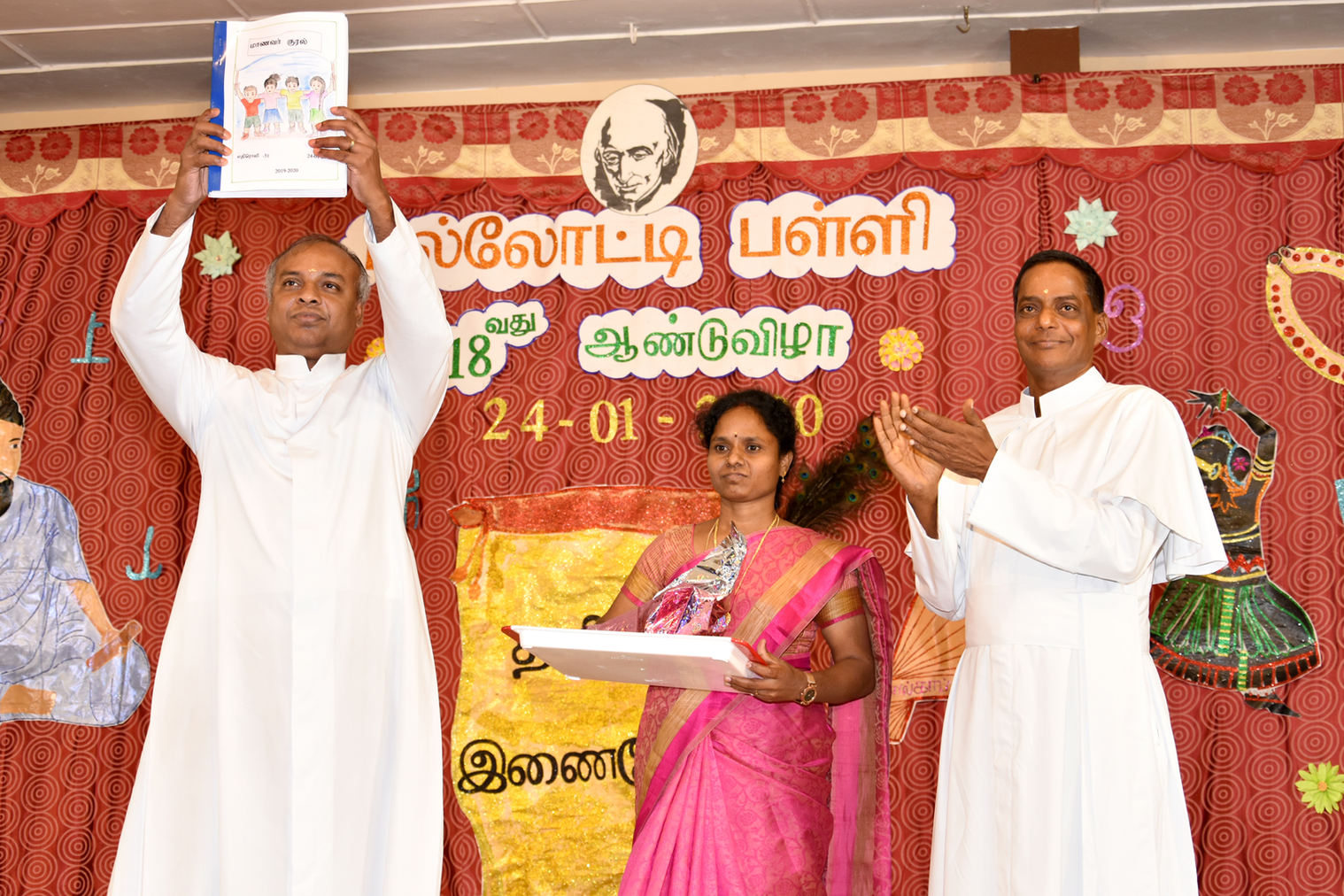 Students' hand written magazine - Manavar Kural - being released by. Fr. Anto Vijayan, SAC
