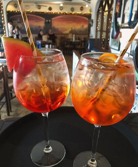 The classic Italian Aperol Spritz alongside our own variation the Watermelon Aperol Spritz