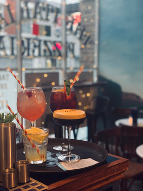Italian Summer Punch, Italian Sangria, Capri Spritz and Espresso Martini cocktails on their way to a table