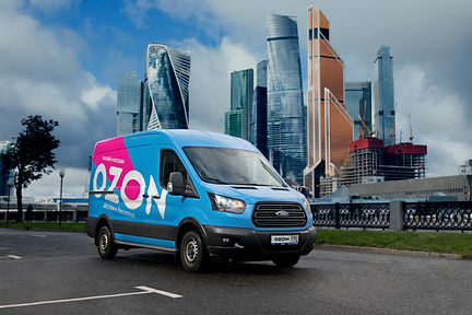 Ozon delivery car in front of Moscow Cit