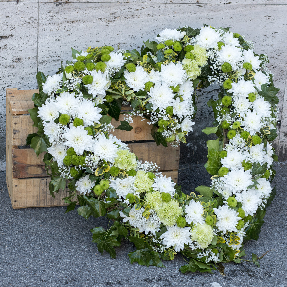 Modern funeral wreath made of white chry