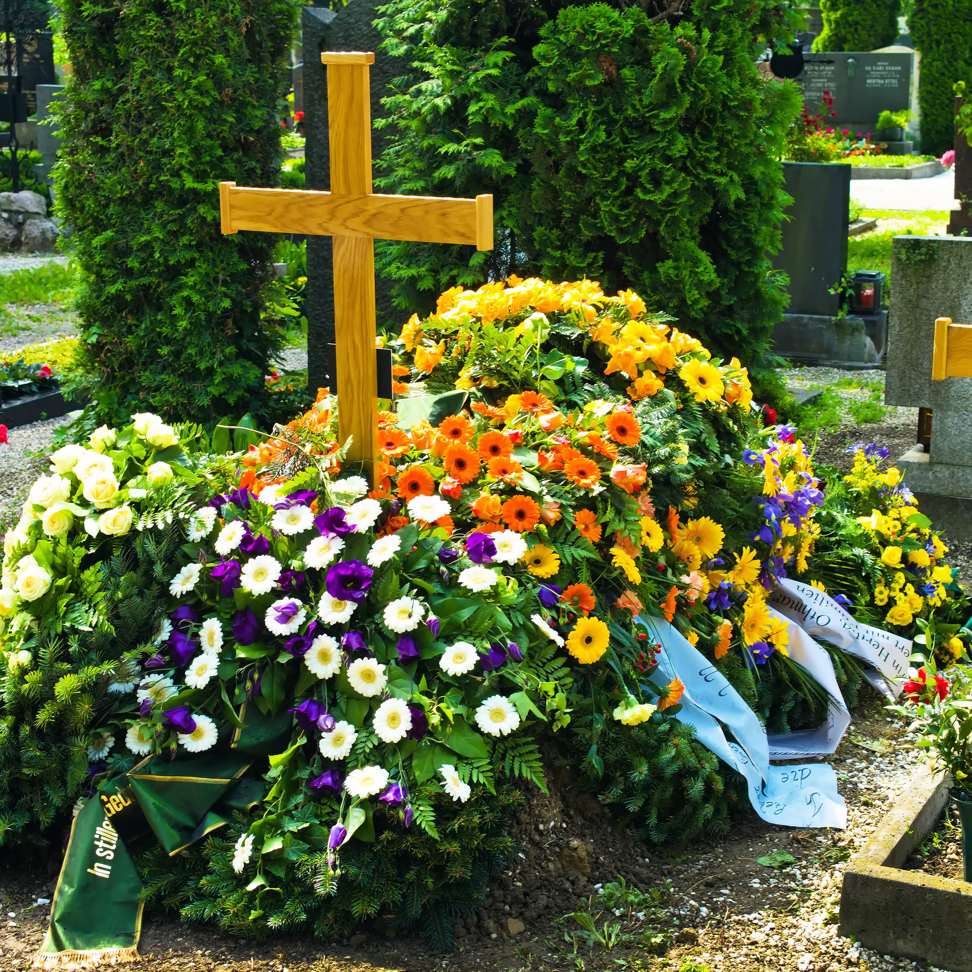 in a cemetery, a grave is fresh after a