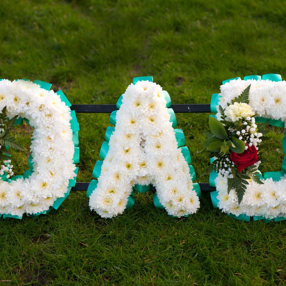 funeral flowers in the name of dad.jpg