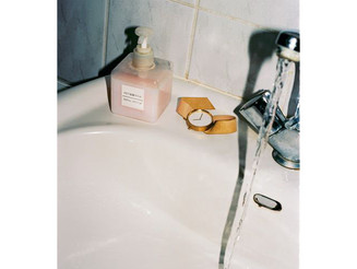 LENA C. EMERY #LenaCEmery #gold #watch placed on a #sink. A #quirky #ad #campaign  Tags:      #campa