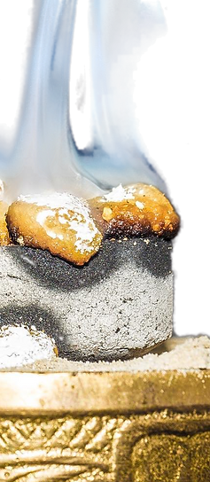 frankincense incense resin burning on charcoal
