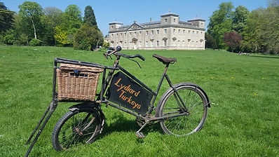 Delivery bike in front of Lydiard House.