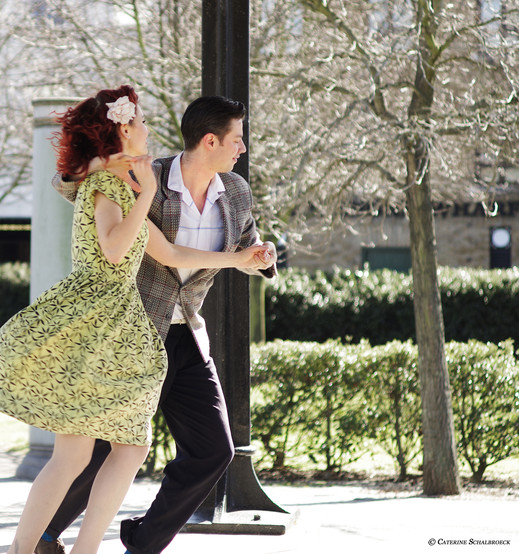 Couple dancing in the park, London.