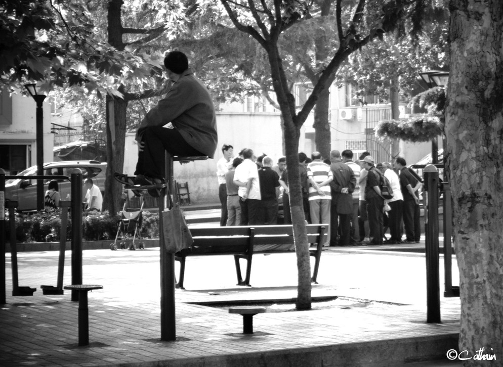 Man looking at a group of people in Qingdao, China