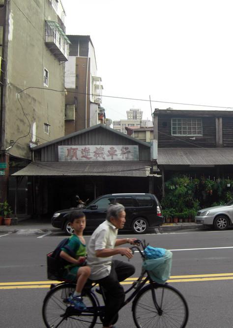 STREET_boy and grandpa cycling.jpg