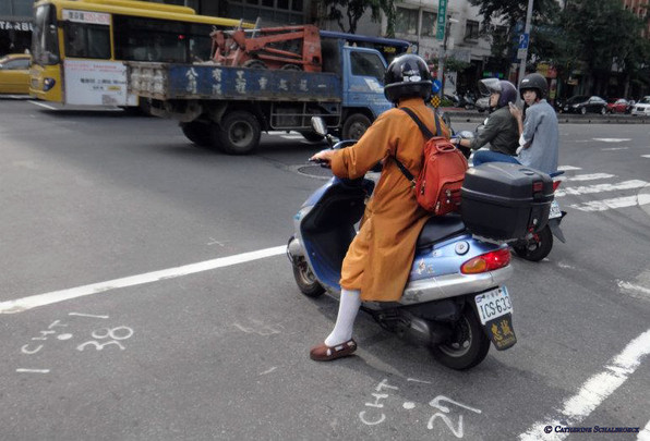 Monk on a moped, Taiwan.