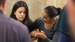 Sara guiding a GJS student through a training exercise