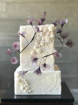 Torn paper effect wedding cake