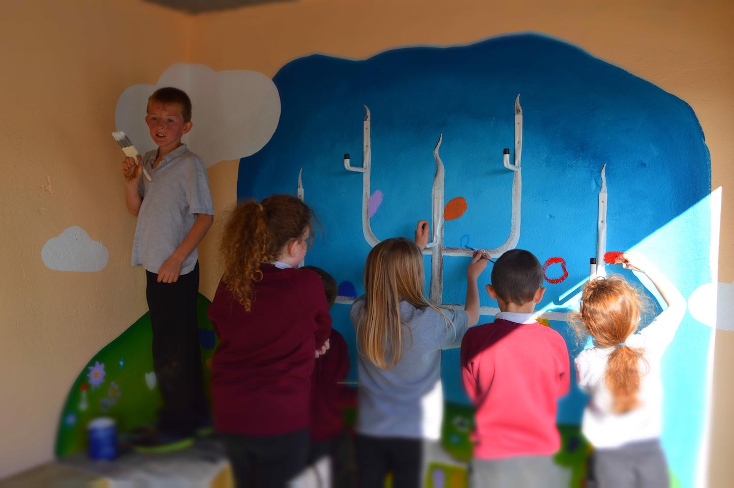 Children painting mural