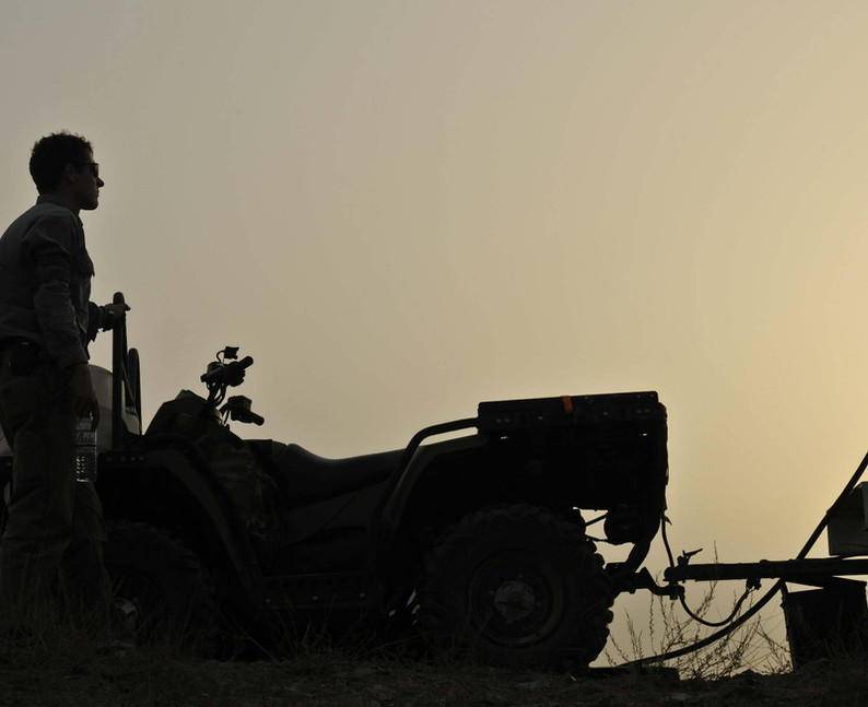 Dusty sunset on the drill rig.