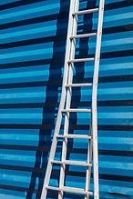 Ladder Against Blue Wall