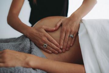 Massage pregnant belly.jpg