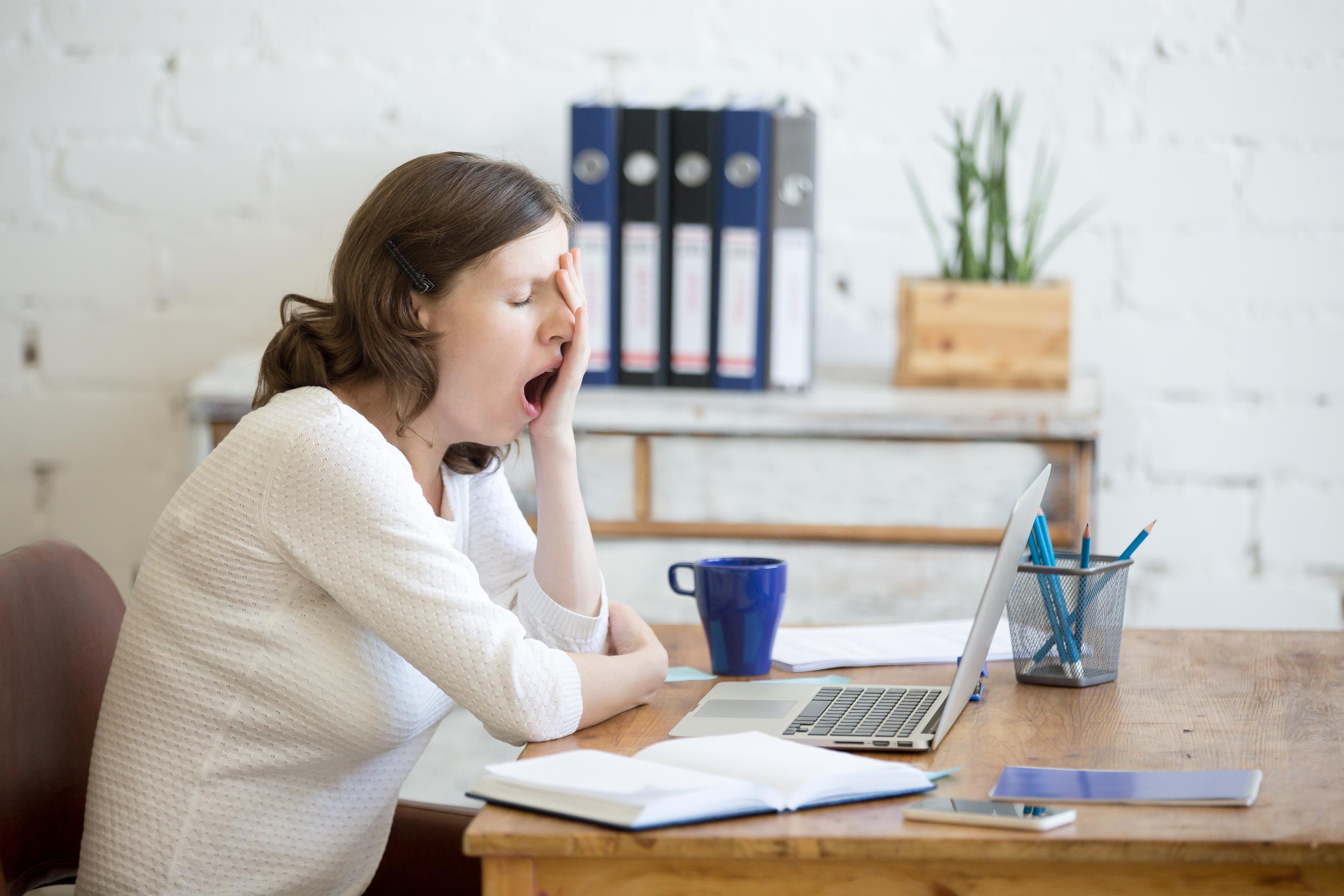 Sleepy Young Worker Woman Yawning