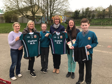 Parents association presenting two sets of jerseys and a set of shorts