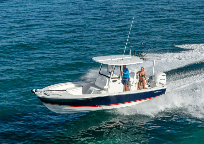 Couple offshore in Regulator 26XO center console fishing boat
