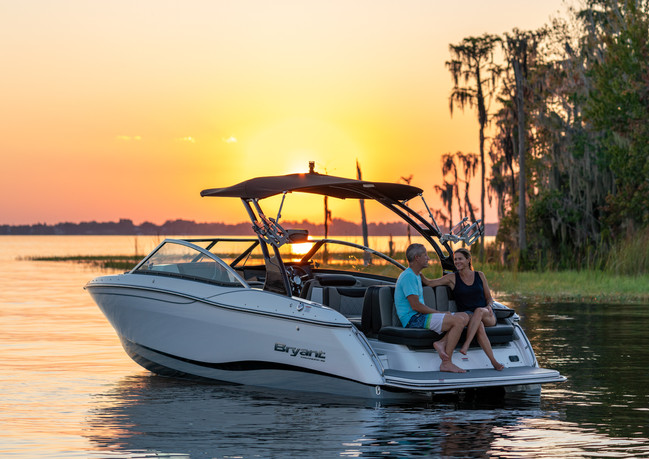 Couple relaxing during sunset on the Bryant Calandra 23 foot boat