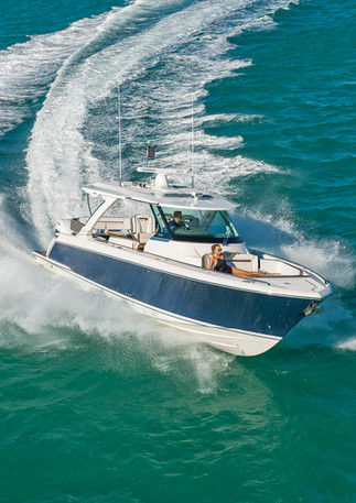 Tiara yacht cruises off shore