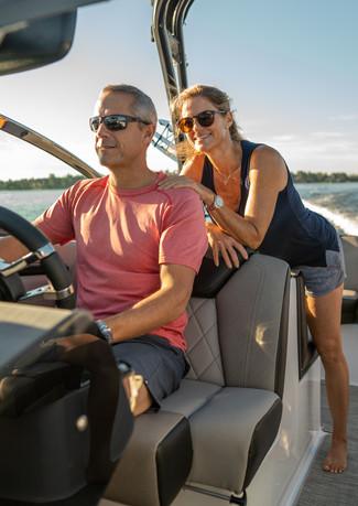 Couple enjoying boat ride.