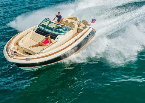 Chris-Craft yacht powers through a turn