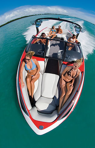 Boat Photography: Overhead fisheye view of passengers in a boat on a beautiful day.