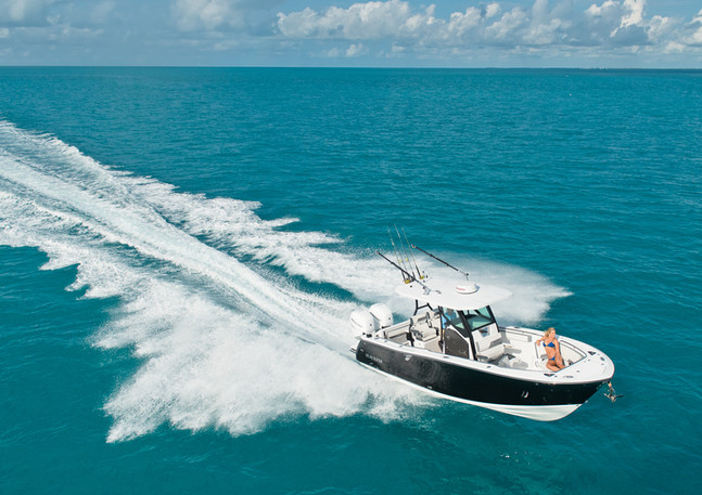 Image of Blackfin fishing boat shot from helicopter in Florida Keys.