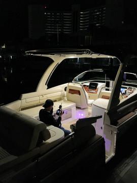 Bill taking interior shot on ChrisCraft boat.