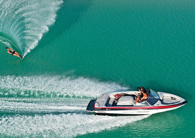 Aerial photography of boat and water skier.