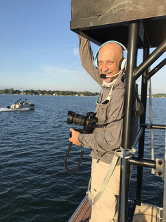 Bill Doster photographing boats on Lake Wawasee, Indiana.