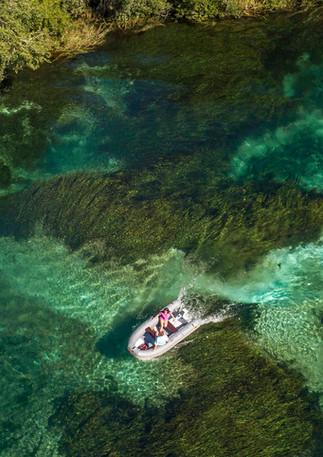 Drone image over boat on Rainbow river.