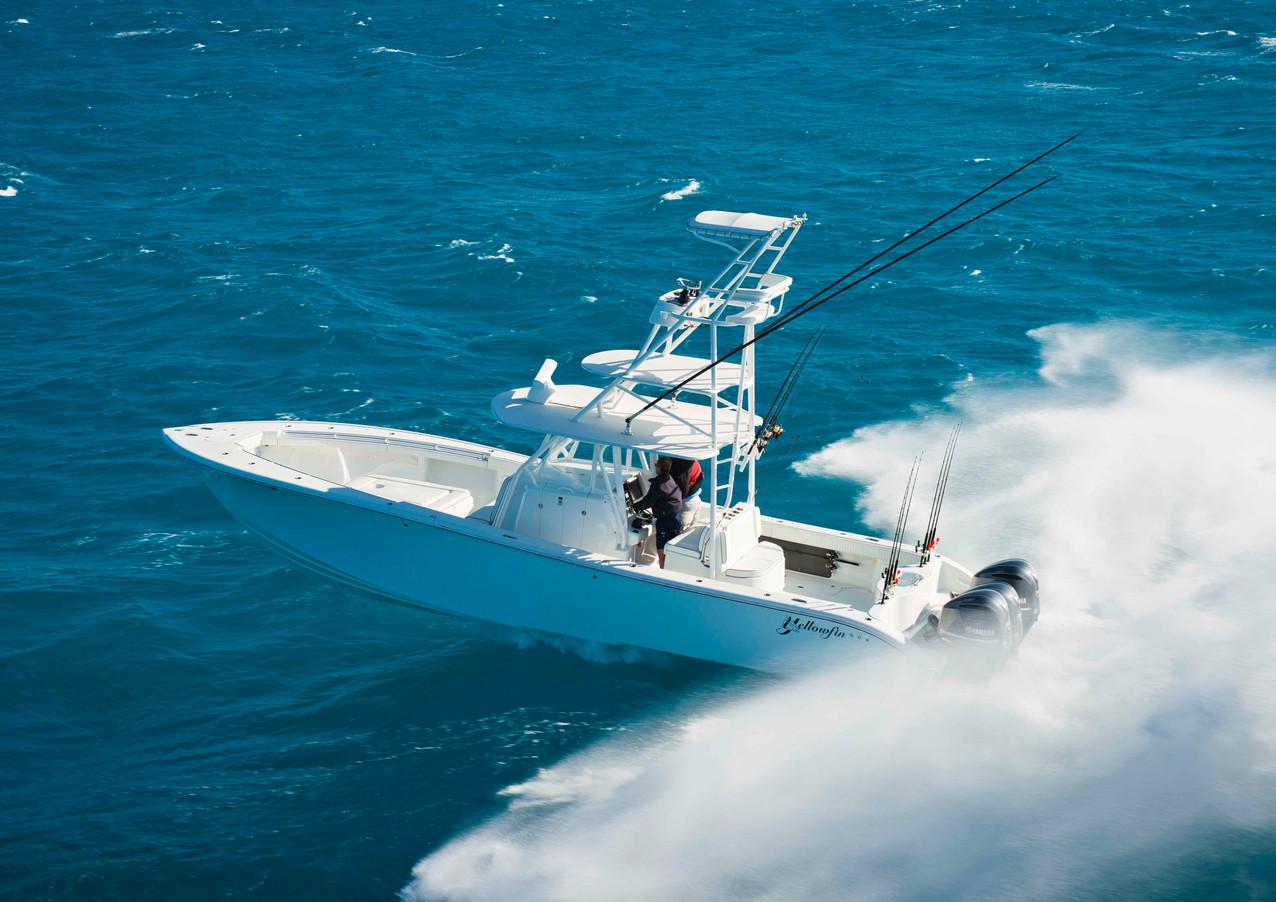 Yellowfin boat crashing through wave image