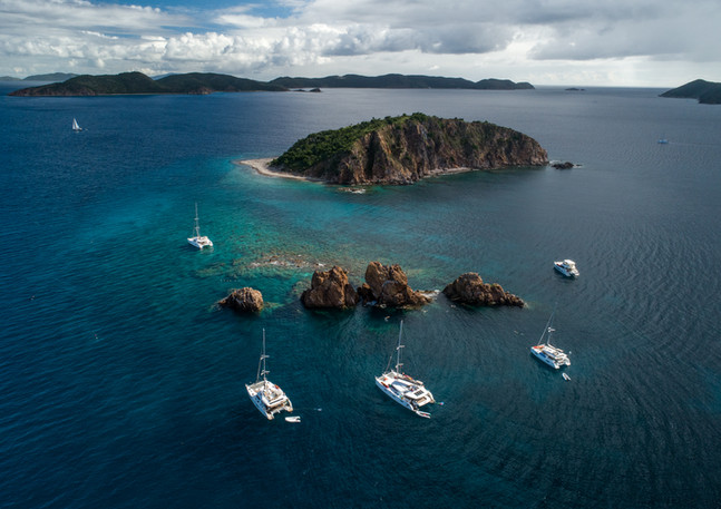 Aerial image of Sailboats anchored in bay.