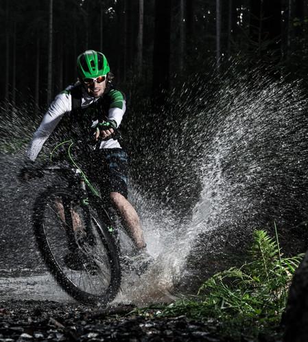 MTB mountain biker in water splash.jpg