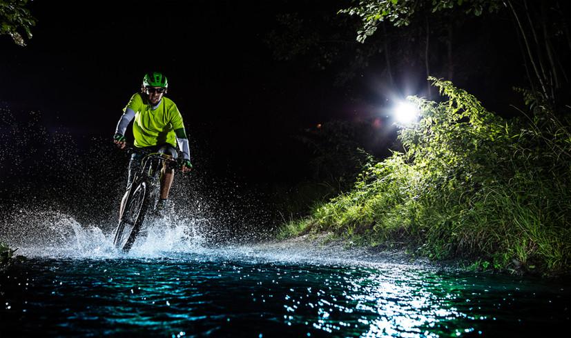 mountain_biker_water_splash_forest_strea