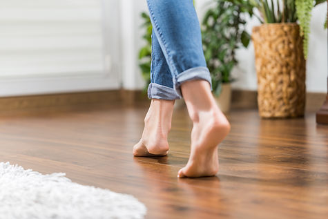 Floor heating. Young woman walking in th