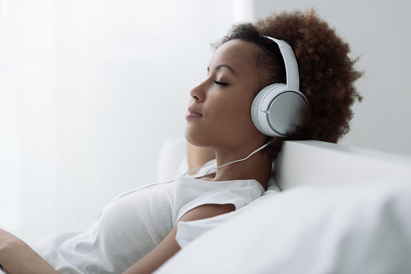 Woman Relaxing And Listening To Music.jp
