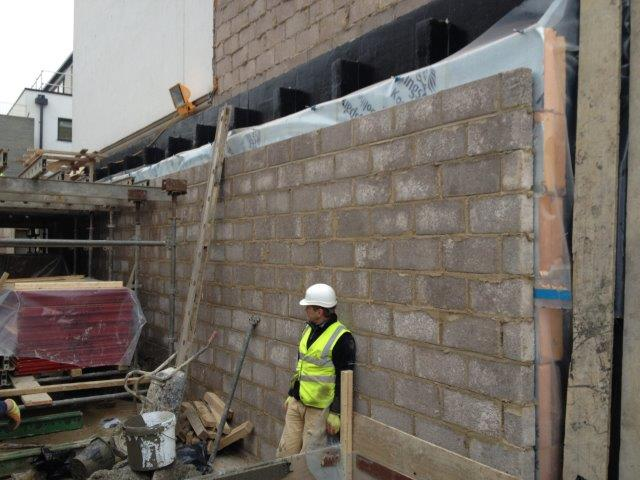 The outer blockwork, although ultimately hidden from view had to be set out as precisely as the finished inner face.
