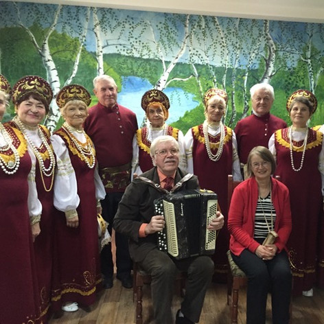 Motovilikhi Veterans of Friendship Choir with leader playing the bayan